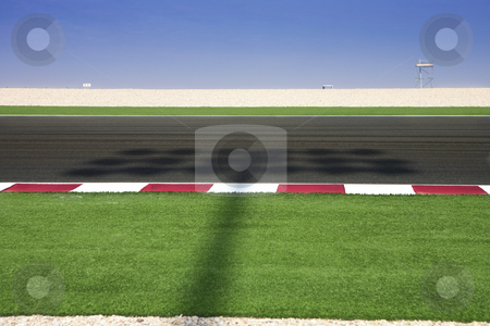 Lusail Race Track stock photo, Section of astro turf and asphalt next to the Lusail GP and race track. Shadow from lighting system running over track. by Sean Nel