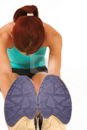 Gym #22 stock photo, A woman in gym clothes, stretching by Sean Nel