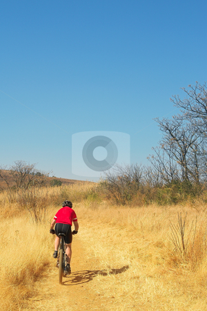 Mountainbiking #6 stock photo, Lone racer on his mountainbike - Copy Space by Sean Nel