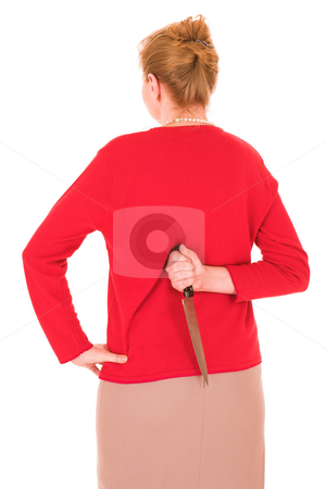 Hand with Knife #3 stock photo, Aggravated wife with knife behind her back by Sean Nel