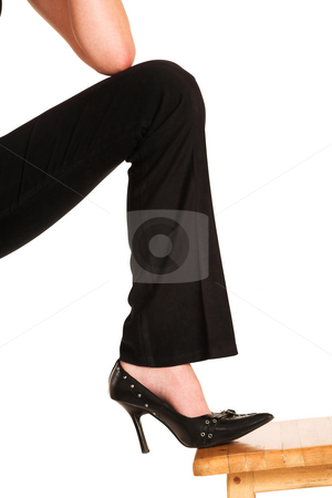 Charmaine Shoultz #48 stock photo, Foot on wooden chair by Sean Nel