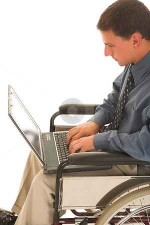 Businessman #121 stock photo, Man sitting in a wheelchair working on a laptop. by Sean Nel