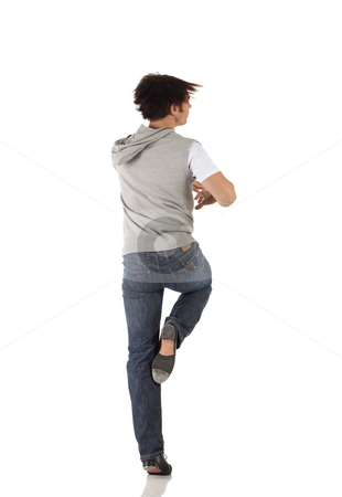 Single male tap dancer stock photo, Single Caucasian male tap dancer wearing jeans showing various steps in studio with white background and reflective floor. Not isolated by Sean Nel