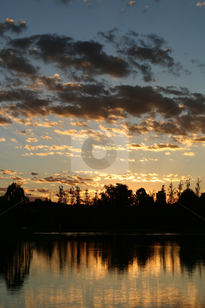 Sunset stock photo, Sunset over water by Sean Nel