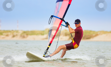 Windsurfer #27 stock photo, Fast moving windsurfer on the water at Keurbooms Lagoon, South Africa  by Sean Nel