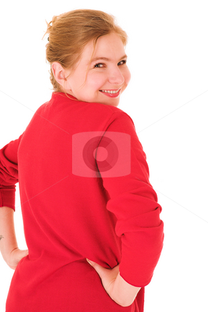 Businesswoman in red looking over shoulder stock photo, Blond adult businesswoman in red pullover looking over her shoulder. Isolated on white. Woman is smiling at viewer by Sean Nel