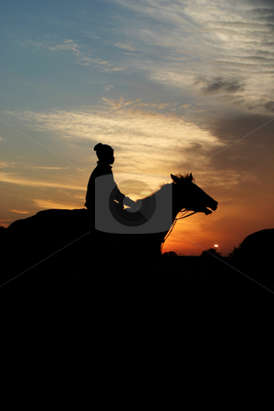 Horse and rider at sunrise stock photo, Warming up the horses for the day's training by Sean Nel