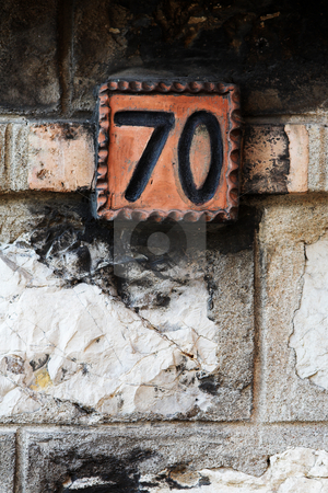 Antibes #5 stock photo, Number of a house against a brick wall. Copy space. by Sean Nel