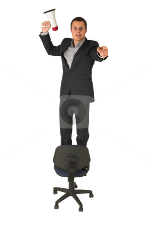 Businessman #241 stock photo, Businessman in a blue shirt, standing on an office chair, holding a megaphone in one hand, pointing with the other. by Sean Nel