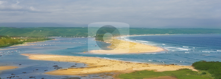 Cloudy day on the beach at Plettenberg Bay stock photo, A cloudy day at the Keurbooms Lagoon next to Plettenberg Bay. Clean golden beaches with people sunbathing on the sand and boats in the water. The new river mouth visible. by Sean Nel
