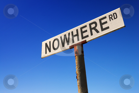 Sign against blue sky stock photo, Weathered old road sign against a clear blue sky - Concept image: Road to NOWHERE by Sean Nel