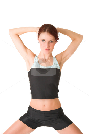 Gym #104 stock photo, Woman standing with her hands behind her head. by Sean Nel