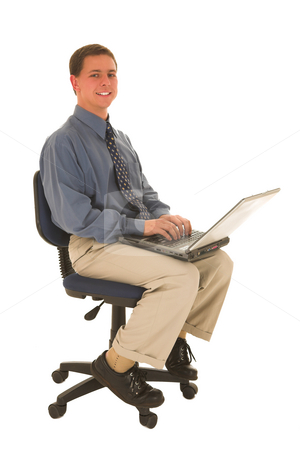 Businessman #46 stock photo, Man sitting on a chair working on laptop. by Sean Nel