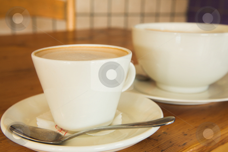Lunch #26 stock photo, Two cups of coffee on a wooden table by Sean Nel