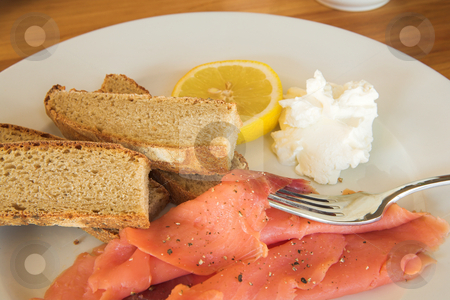 Lunch #18 stock photo, Whole wheat bread with salmon, lemon and cream on a plate by Sean Nel