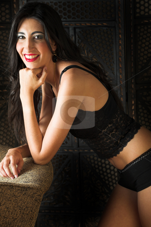 Beautiful young Italian woman in black Lingerie stock photo, Beautiful young sexy adult Italian woman with long black hair, in black lace lingerie on a textured wooden background  by Sean Nel