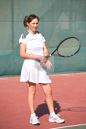 Female Tennis Players stock photo, Young woman playing tennis in the sun by Sean Nel