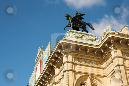 Statue on top of building in Vienna stock photo, Statue of a man on top of horse on a roof of building in Vienna, Austria by Sean Nel