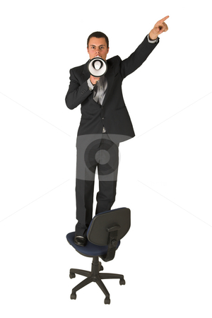 Businessman #240 stock photo, Businessman wearing a suit and a grey shirt.  Making a stunt on an office chair with a megaphone in his hand, pointing upwards with his other hand. by Sean Nel