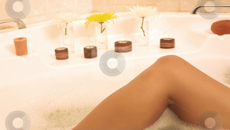 Woman #49 stock photo, Leg of a female in a bath. by Sean Nel