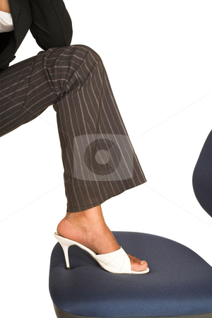 Mida Matsimela #19 stock photo, African business woman dressed in black jacket, white shoes and brown pinstripe pants.  Foot on office chair. by Sean Nel