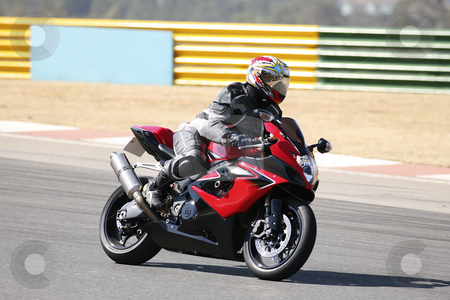 Superbike #79 stock photo, High speed Superbike on the circuit  by Sean Nel