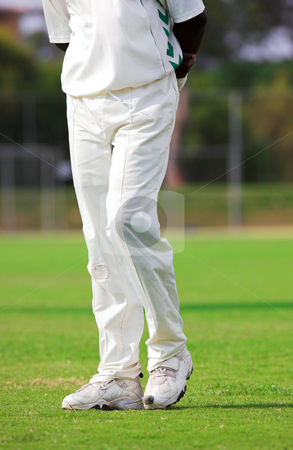 Cricket #2 stock photo, Walking Cricketer playing in the late afternoon - Focus on left shoe by Sean Nel