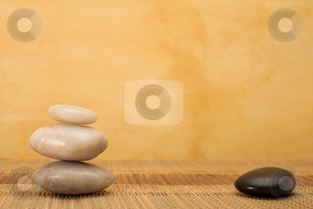 Massage #37 stock photo, Hot stone massaging stones on bamboo cloth in front of wall - copy space by Sean Nel