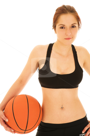 Woman with basketball ball stock photo, Isolated young adult Caucasian woman holding a basketball in her one hand by Sean Nel