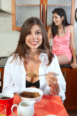 Sexy brunette roommates stock photo, Sexy young adult brunette roommates in lingerie eating breakfast and drinking coffee in their kitchen before work by Sean Nel