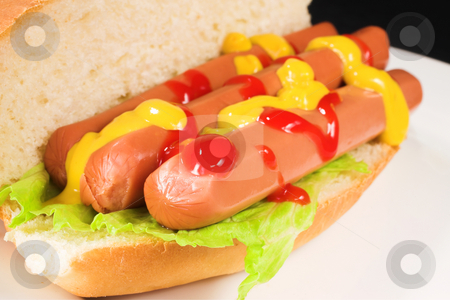 Food #27 stock photo, A hot dog covered in tomato sauce and mustard on a white plate by Sean Nel