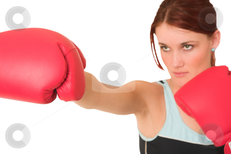 Gym #60 stock photo, Woman wearing boxing gloves.  Looking serious. Shallow d.o.f  -  face out of focus, gloves in focus. by Sean Nel