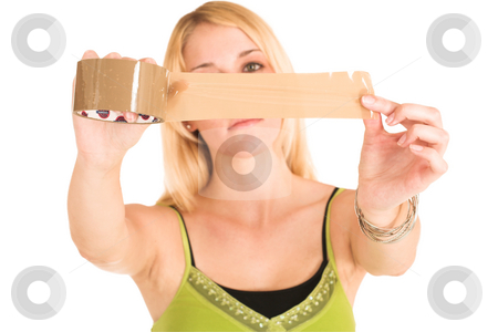 Businesswoman #456 stock photo, Blonde business lady in an informal green top. Holding a piece of tape.  shallow DOF, tape and hands in focus, face out of focus. by Sean Nel