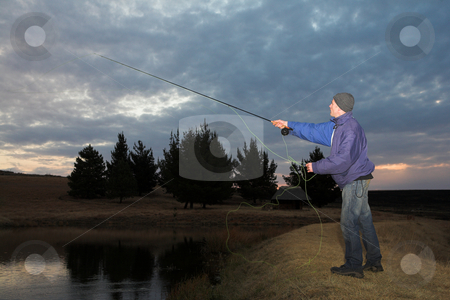 Flyfishing #28 stock photo, A fly fisherman casting a line in Dullstroom, South Africa by Sean Nel