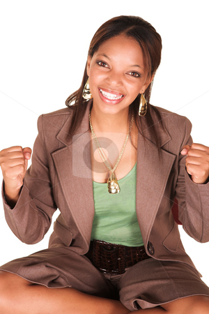 Ecstatic successful African businesswoman isolated on white stock photo, A short smiling African businesswoman with brown trousers and a short sleeved green top and a faux leather belt. She has both arms in fists and is smiling at the viewer. Isolated on white. by Sean Nel