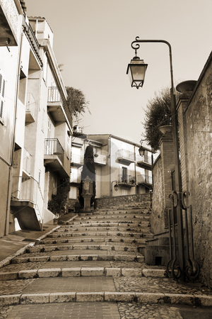 Street with walkway in Cannes stock photo, Street with buildings and paved brick walkway in Cannes, France. Sepia tone by Sean Nel