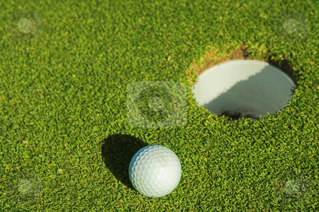 Golfer #36 stock photo, A golf ball on a green. by Sean Nel