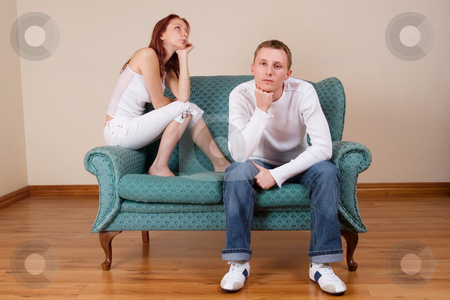 Trudy-Lee & Tommy #1 stock photo, Woman and boyfriend sitting on couch, looking  bored by Sean Nel