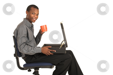 Businessman #161 stock photo, Businessman sitting on an office chair, holding a mug with suitcase on his lap.  Copy space. by Sean Nel