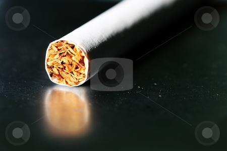 Tobacco #2 stock photo, Single cigarettes on a cigarette case by Sean Nel