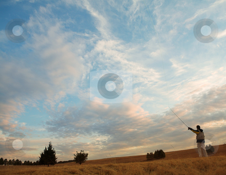Flyfishing #4 stock photo, A fly fisherman casting a line in Dullstroom, South Africa - Copy space by Sean Nel
