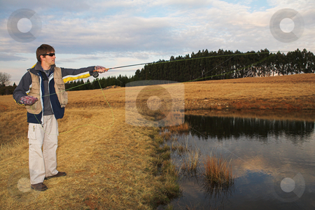 Flyfishing #13 stock photo, A fly fisherman casting a line in Dullstroom, South Africa by Sean Nel
