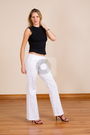 Woman #12 stock photo, Beatiful blonde woman with white pants and a black top by Sean Nel