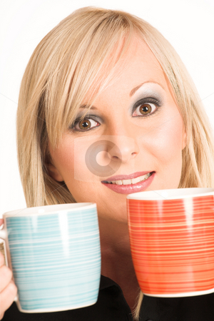 Business Woman #301 stock photo, Blond business woman dressed in black trousers and a black shirt.  Holding two mugs. by Sean Nel