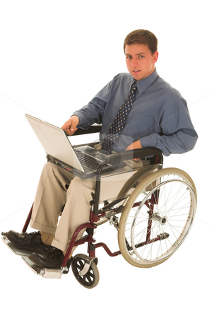 Businessman #141 stock photo, Businessman sitting in a wheelchair working on laptop by Sean Nel
