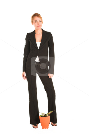 Businesswoman #239 stock photo, Blonde business lady in formal black suit.  Standing behind a small potplant. by Sean Nel