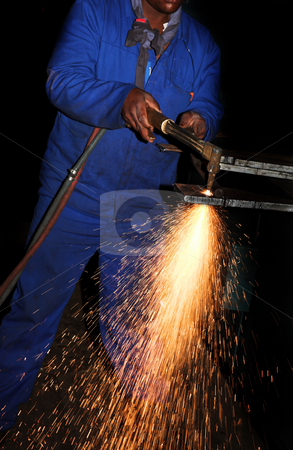 Plasma Cutter #3 stock photo, Worker in Blue safety overalls working with Plasma cutter - Focus on sparks by Sean Nel