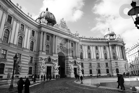 Building in Vienna stock photo, Building with statues infront in Vienna, Austria with people in the street. Black and white by Sean Nel