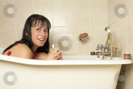 Woman #107 stock photo, Nude woman in a bath, holding a champagne glass by Sean Nel