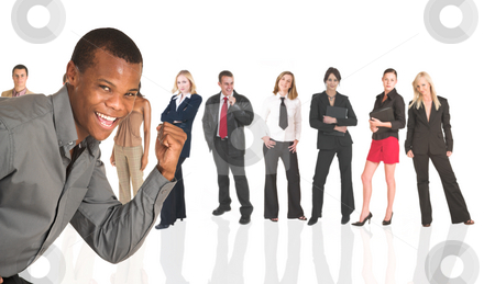 Black African businessman standing in front of a business people stock photo, Black african businessman standing in front of a group of business people all isolated on white. The whole group consists of multiracial young adults. The foreground is in sharp focus with the people in the background slightly blurred. by Sean Nel